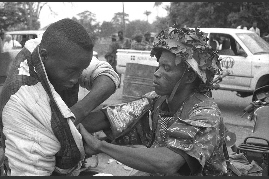 A soldier searches a man.