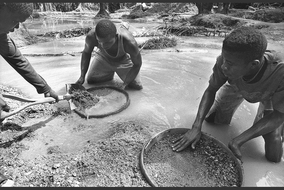 Men washing gravel in a diamond mine.