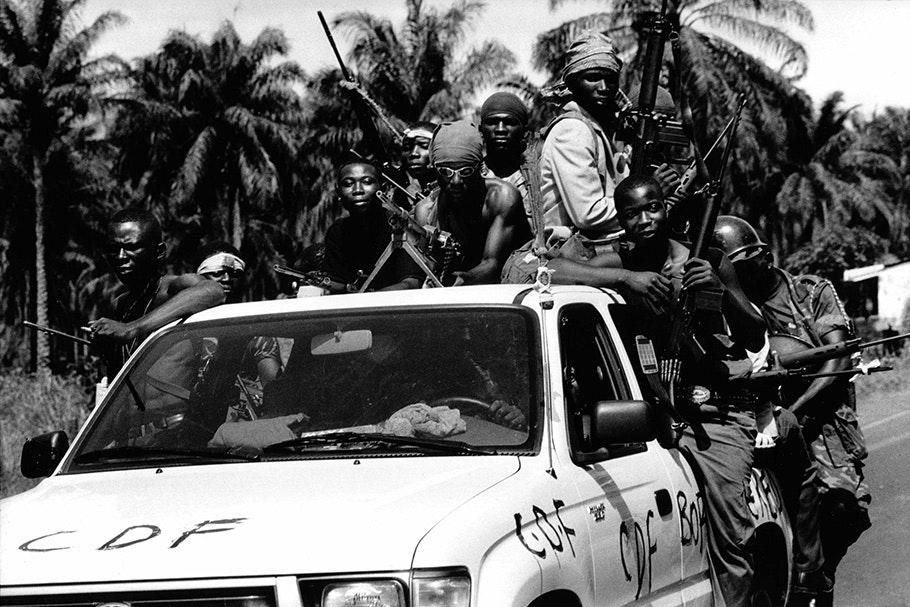 Armed men in a pickup truck.
