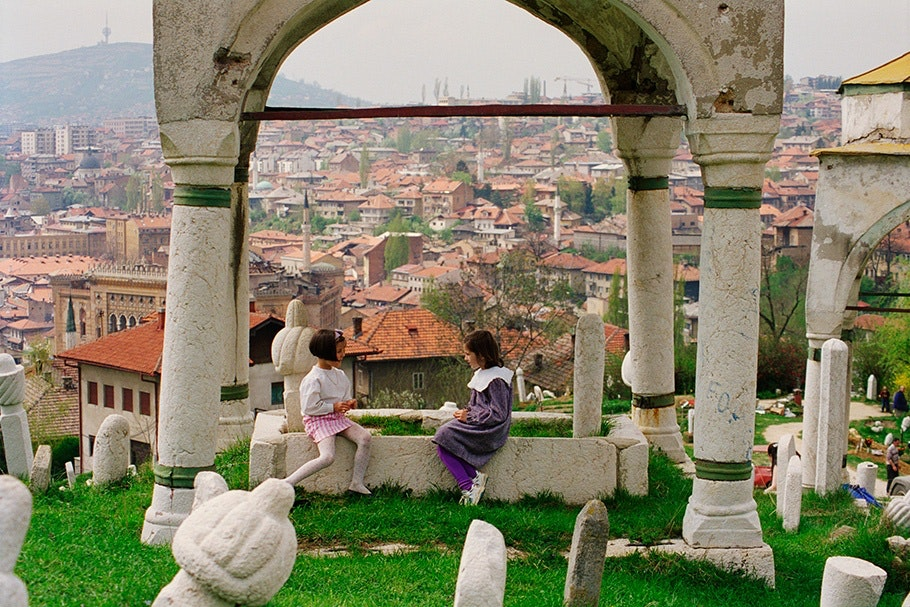 Children playing in a cemetery.
