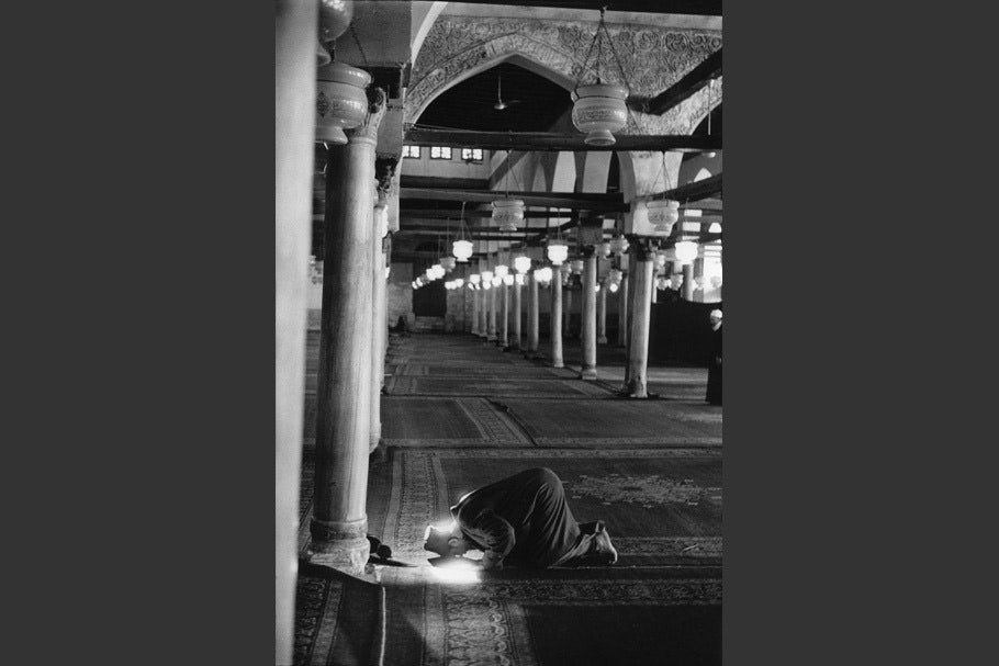 A man prays in a mosque.