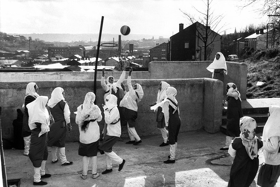 Schoolgirls playing basketball.