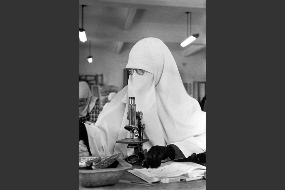 A woman with a microscope.