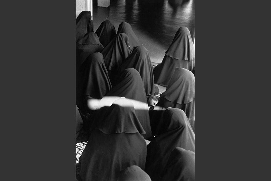 Women veiled in black.