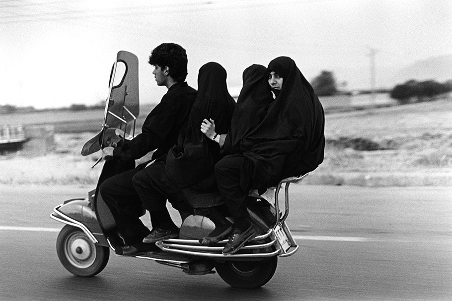 Four people on a motorcycle.