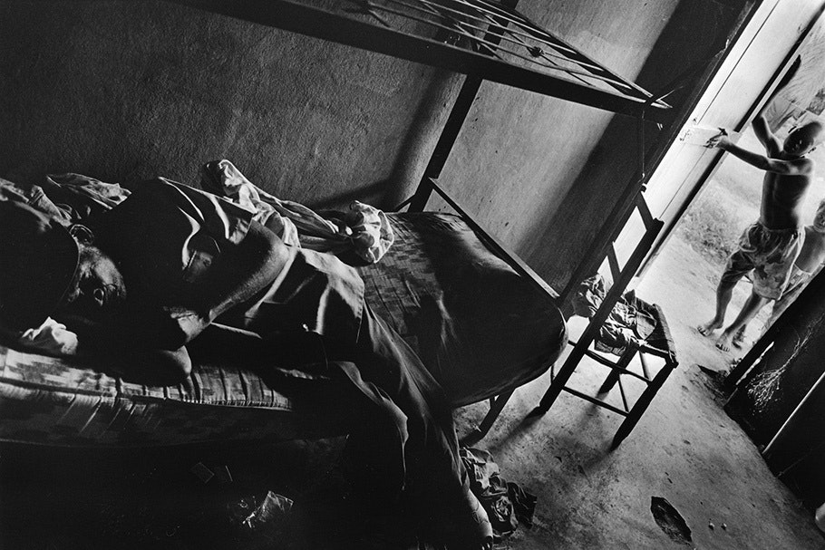A dying man on a bunk bed.
