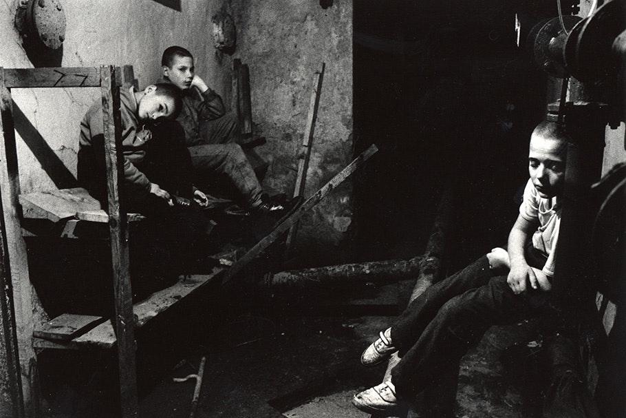 Three boys in a basement.