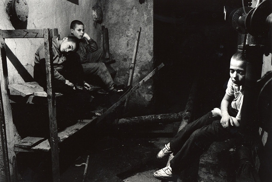 Three boys in a basement.