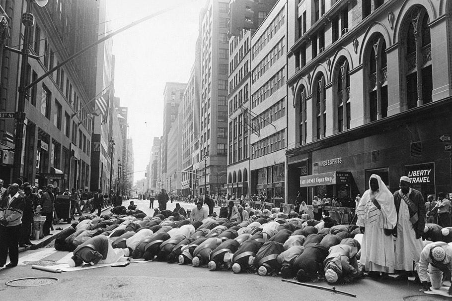 Muslim men praying in a Manhattan street.