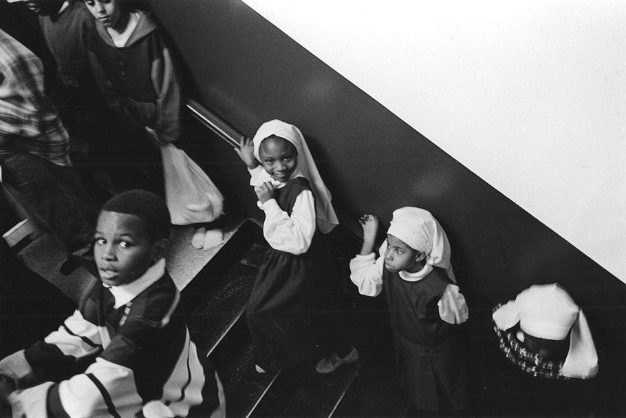 Schoolchildren on a staircase.