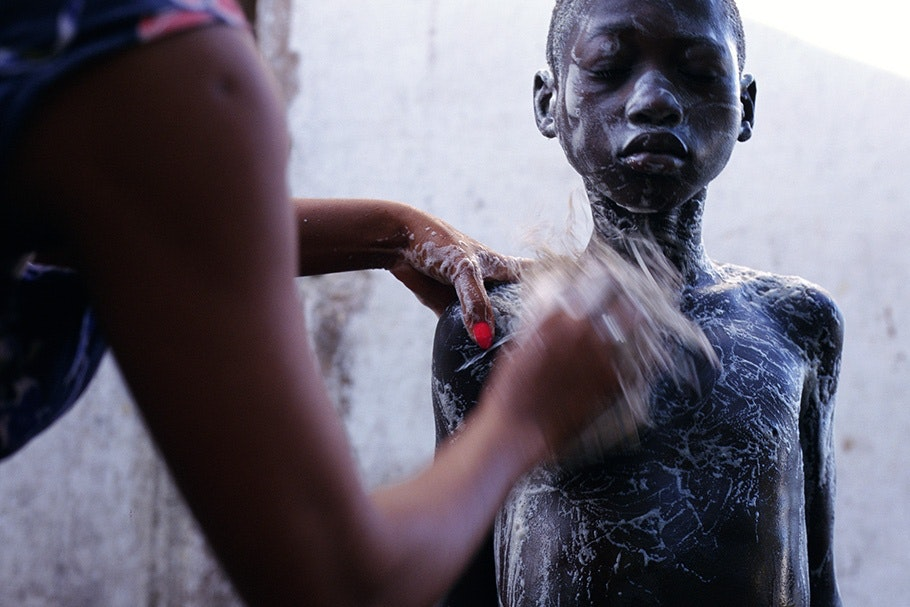 A boy being bathed.