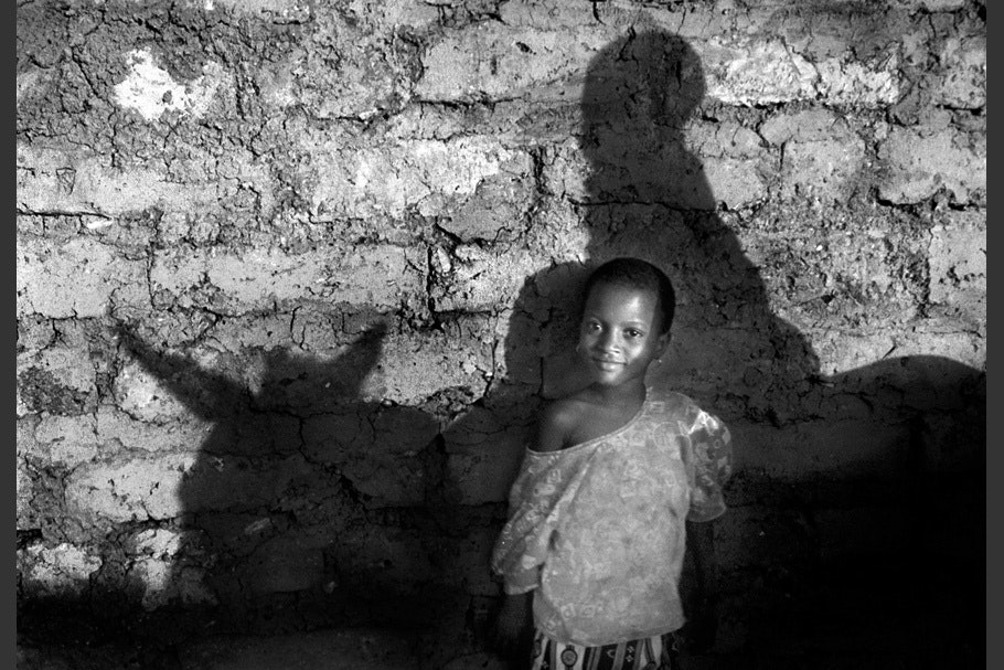 A child with a shadow of a donkey.