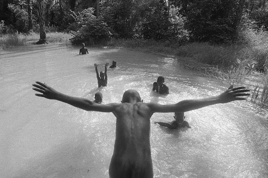 A child dives into water