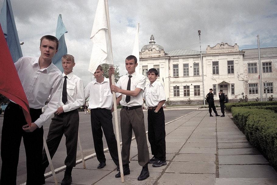 Teenage boys in ties with flags.