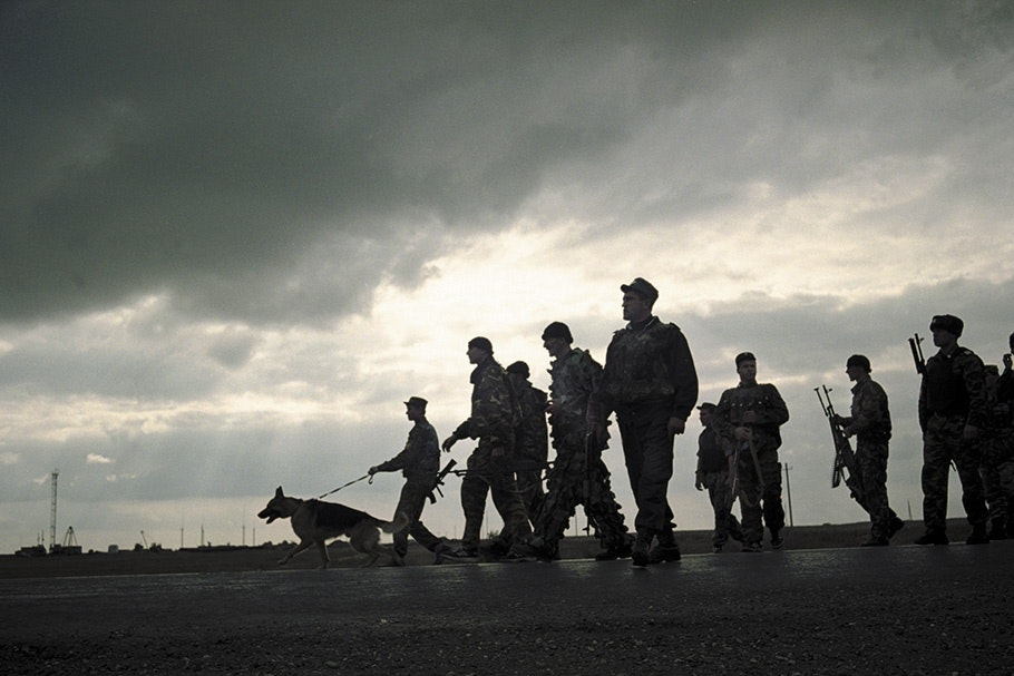 Soldiers with a dog.