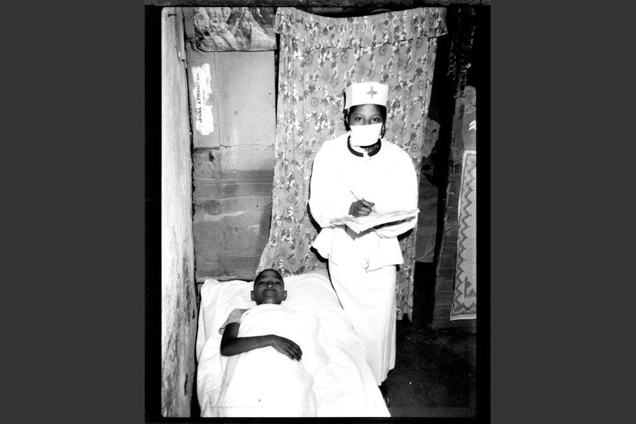 Children playing doctor and patient.