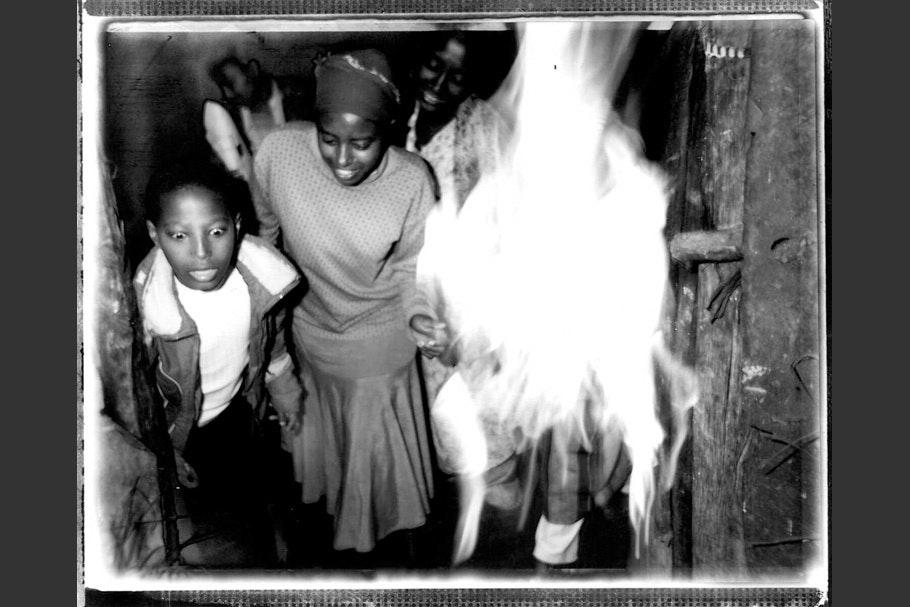 Children next to a fire.