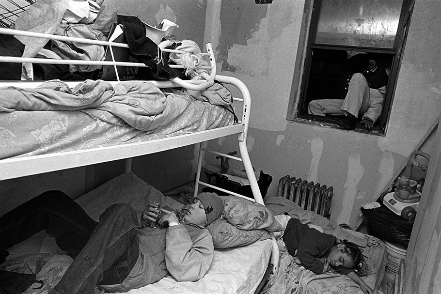 A family in a room with bunkbeds.