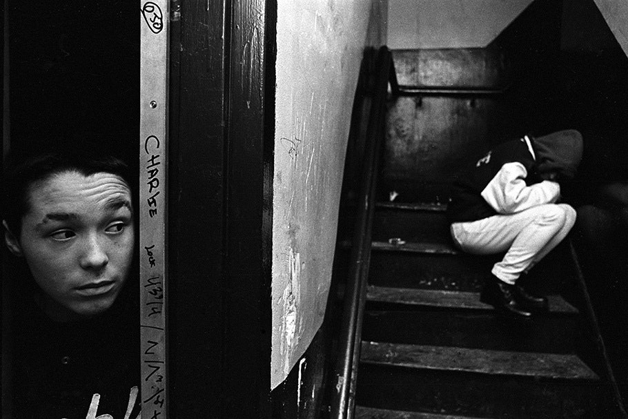 A boy looks into a stairway.