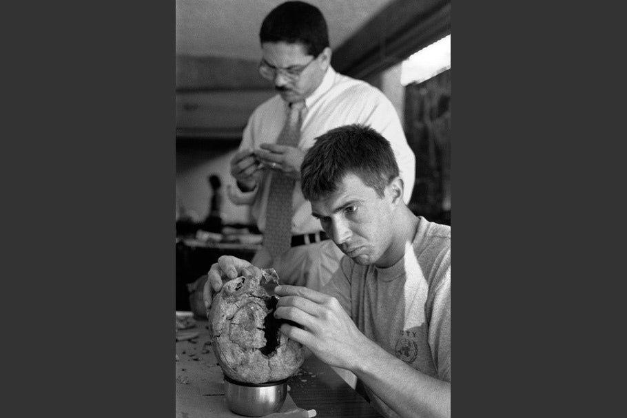 A man working on a skull.