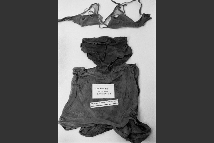 A woman's clothing and undergarments on a table.