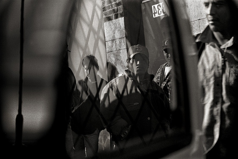 Workers viewed through a reflection.