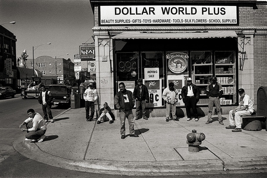 Workers outside of a dollar store.