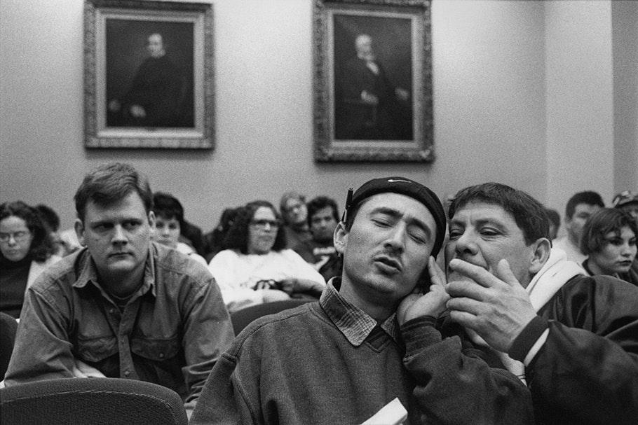 Audience sitting in room.