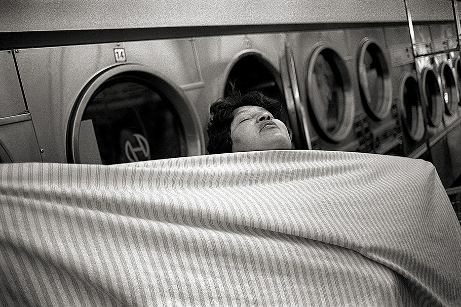 A woman in a laundromat.