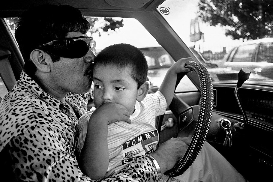 A father and son in a car.