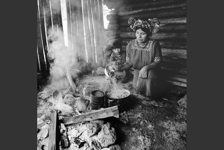 Women tending a kitchen fire.