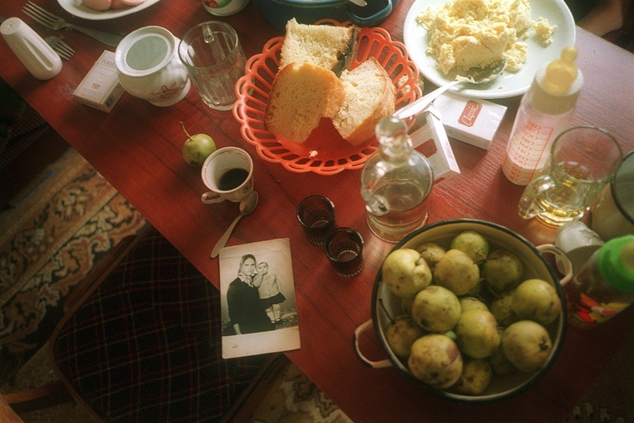 Table with food and photograph.