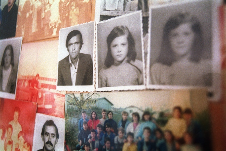 Several rephotographed snapshots on a wall.