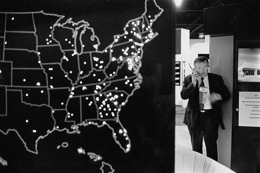 A man on the phone next to a US map.