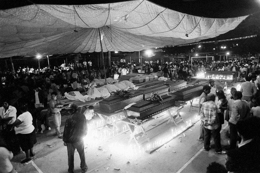 Coffins at a mass funeral.