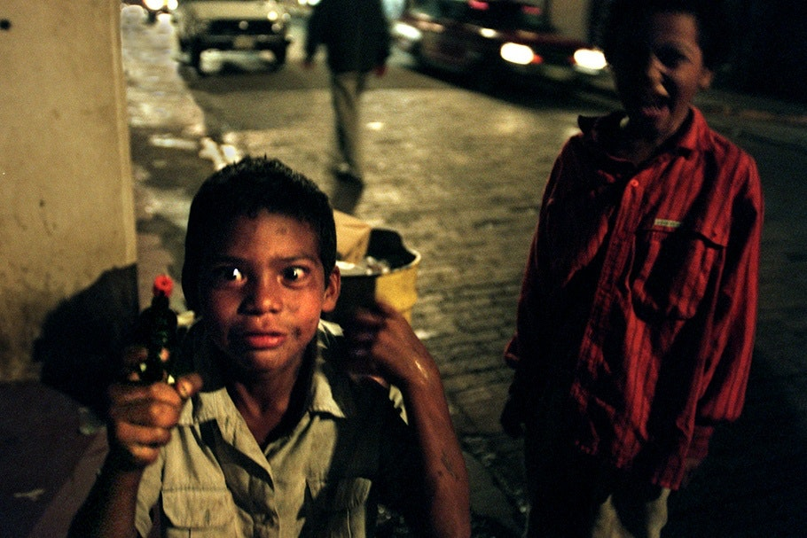 Two boys with a toy gun.