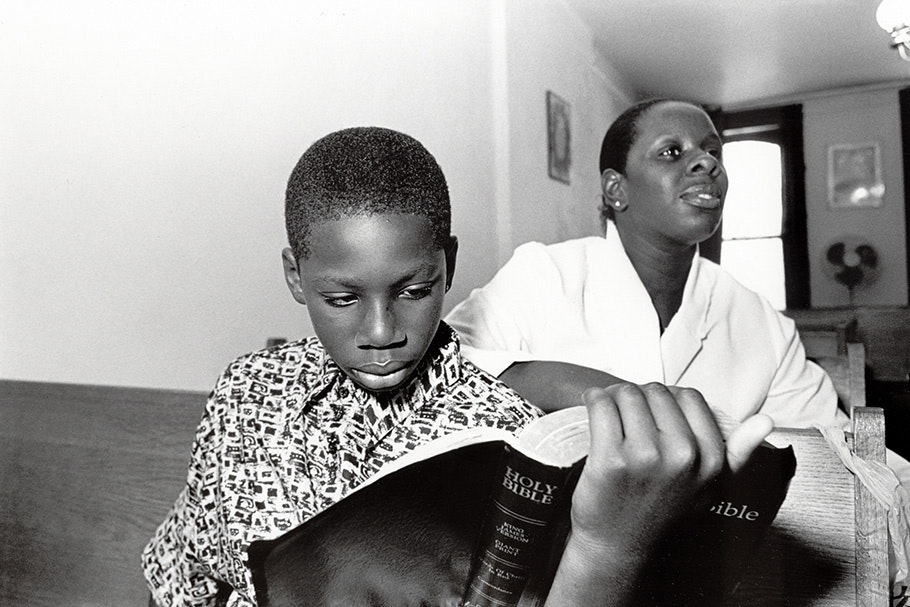 Mother and son reading the Bible.