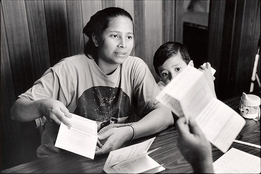 Mother and son with vaccination records.