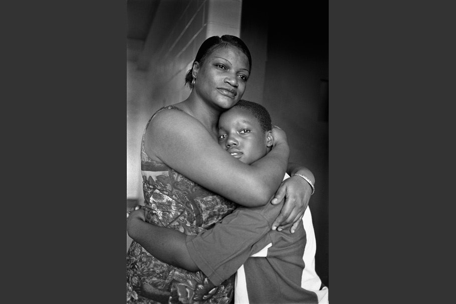 Mother and son embracing.