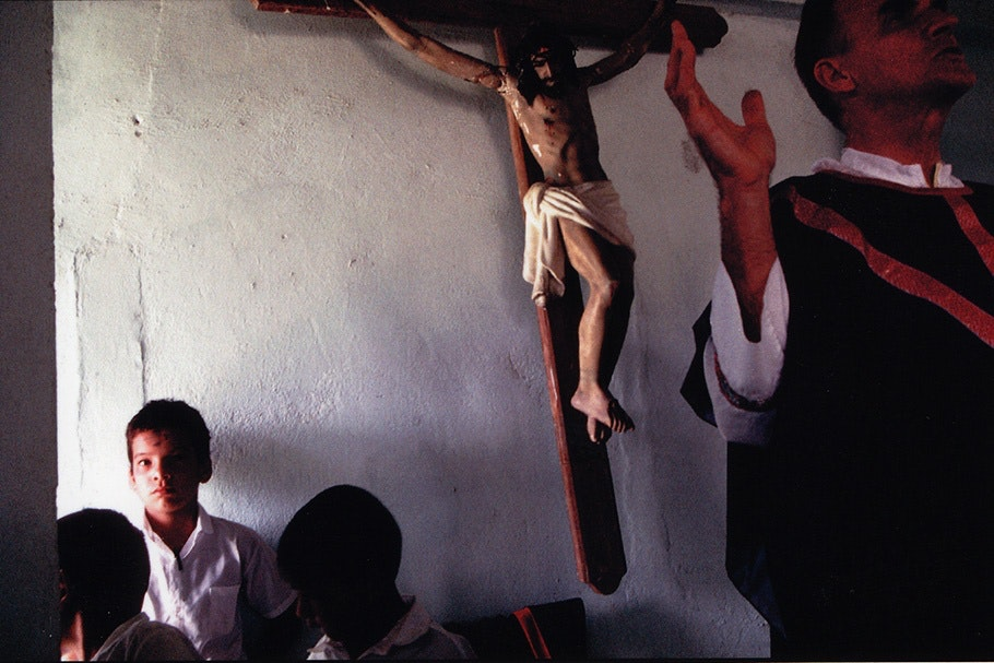 Boys under a crucifix.