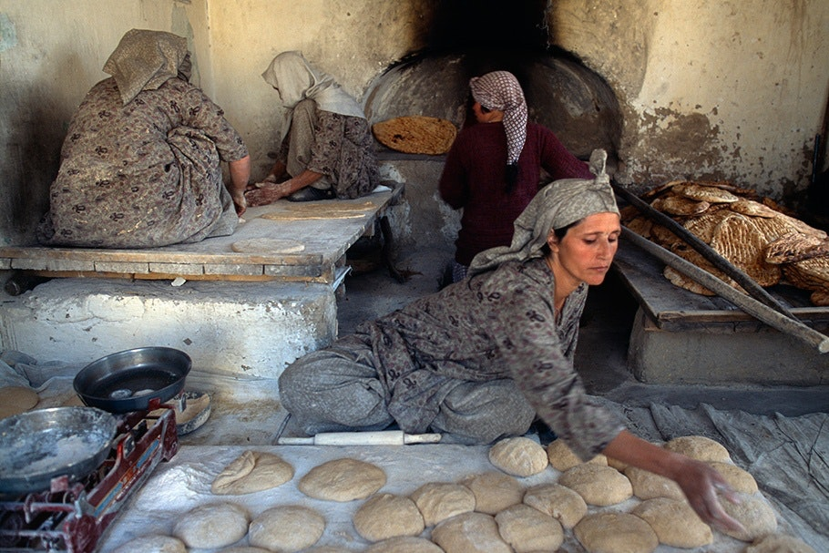 Women baking bread.