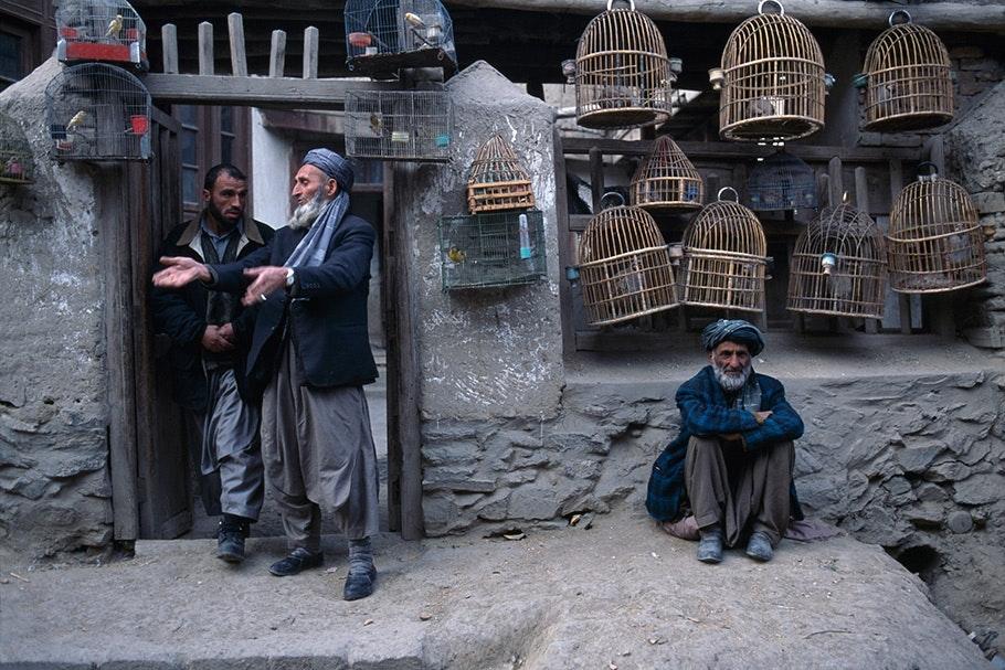 Men selling birdcages.