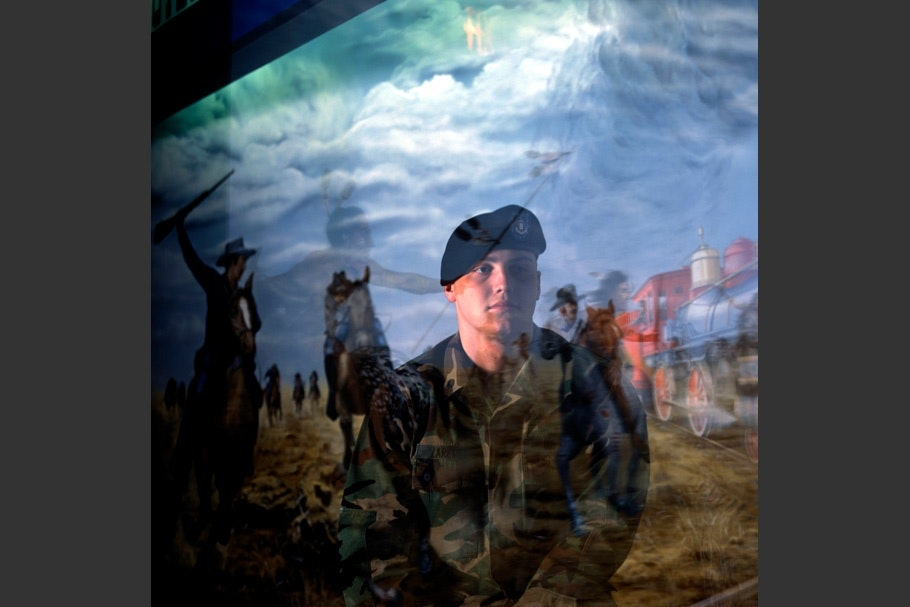 Soldier reflected in museum display glass.