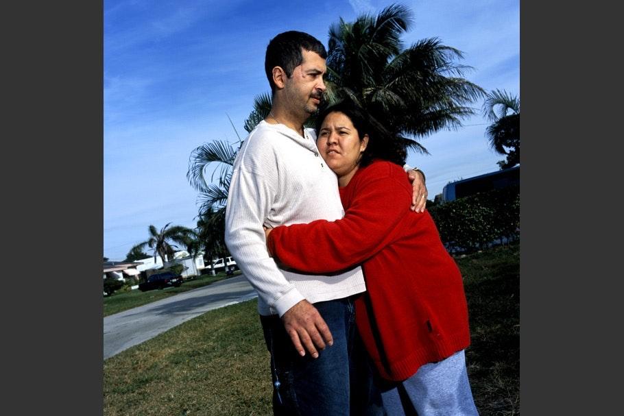 Woman hugging a man.
