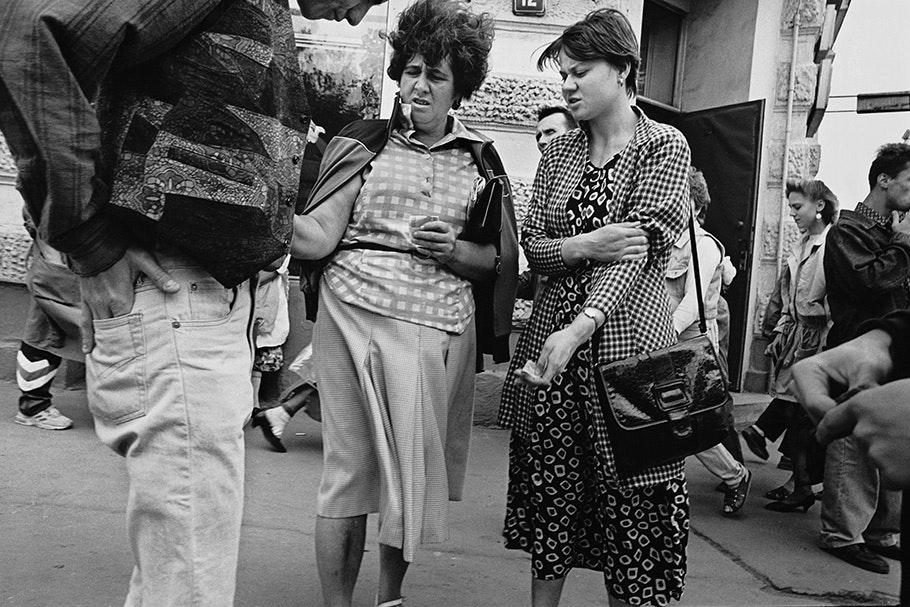 Two women in patterned dresses.