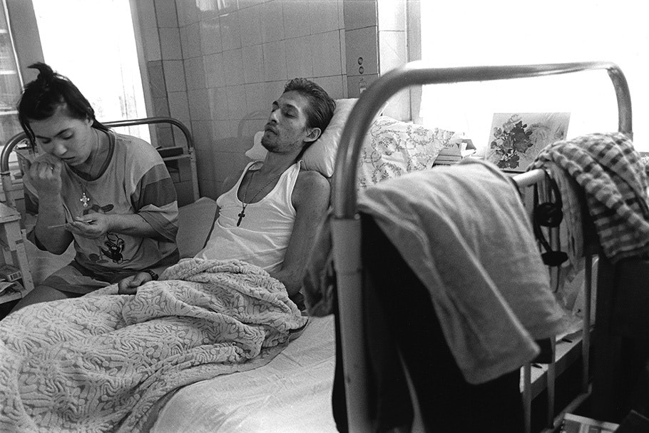A couple on a hospital bed.