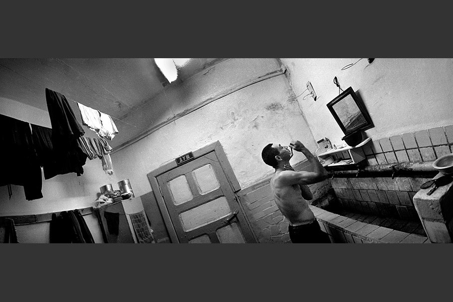 Panorama of a man shaving.
