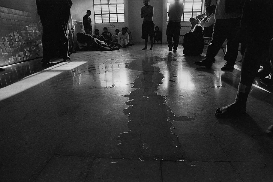 A stream of urine in the middle of a floor.