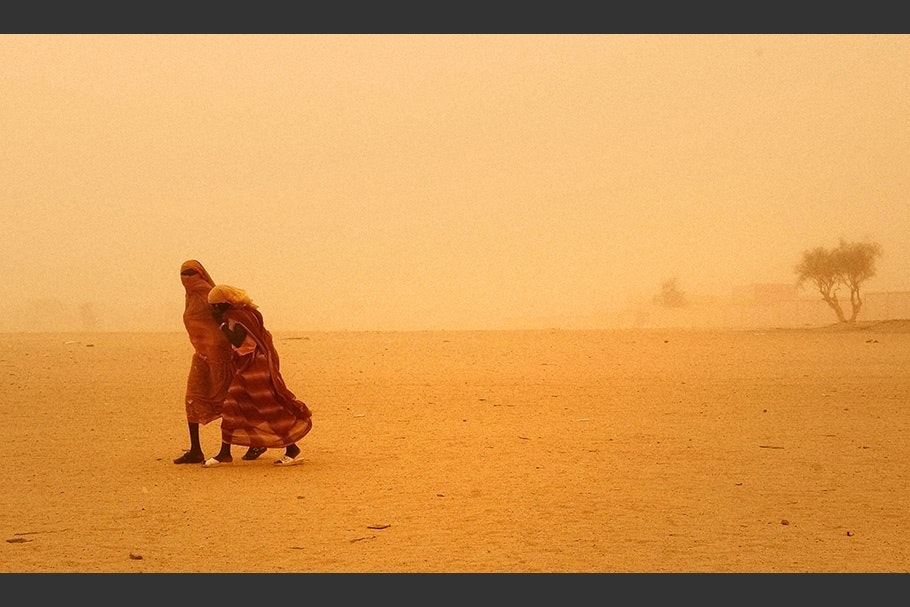 Two girls in a sandstorm.