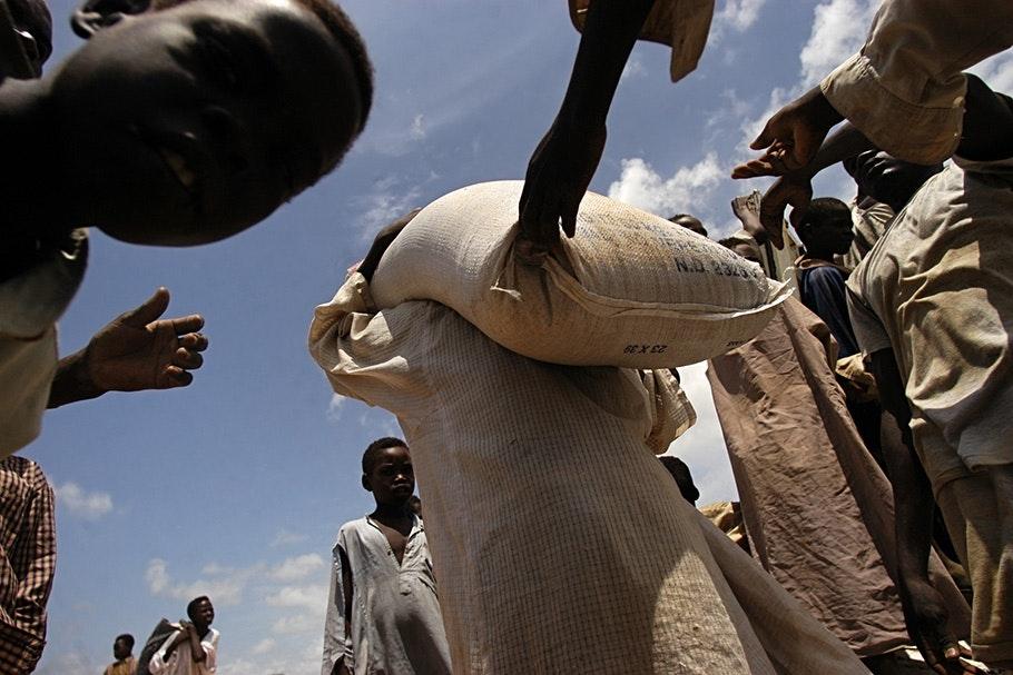 People carrying sacks of food.